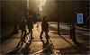 Silhouettes on Mosley Street (Fermat48) Tags: mosleystreet manchester piccadillygardens settingsun sunset silhouette rimlight digitaldisplay canon eos7dmarkii construction buildingwork bollards
