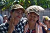 ladies who really wanted to be photographed (the foreign photographer - ฝรั่งถ่) Tags: two ladies caps peace signs our street new monk procession parade bangkhen bangkok thailand nikon d3200
