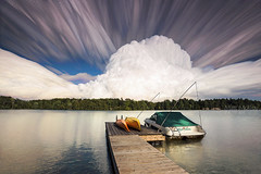 Whipped Cream Clouds Over Cranberry Lake (Matt Molloy) Tags: mattmolloy timelapse photography timestack photostack movement motion big fluffy cloud formation cumuluscongestus lines trails boat kayaks dock water reflections trees cranberrylake burnthills ontario canada landscape nature countryside cottage lovelife