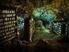 Okinawa Cave (Stuck in Customs) Tags: japan okinawa rcmemories 80stays treyratcliff stuckincustoms stuckincustomscom hdr hdrtutorial hdrphotography aurorahdr cave sake age process light bottle alcohol dark