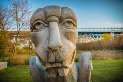 Duane Linklater, Monsters for Beauty, Permanence and Individuality, 2017 (A Great Capture) Tags: face autumn fall bridge bloorviaduct gargoyles donvalley lowerdontrail outdoors art sculpture farm canada ontario toronto agreatcapture explorethedonvalley superpark donvalleytrails changingoftheleaves streetart depthoffield dof streetphotography streetscape street calle history woods trees tree arbre forest wald leaves leaf foliage autumnleaves stone stones rock rocks outdoor eos digital dslr lens canon 70d agc wwwagreatcapturecom adjm ash2276 ashleylduffus ald mobilejay jamesmitchell on canadian photographer northamerica torontoexplore automne herbst autunno 2017 bloor viaduct lowerdonvalleytrail trail duanelinklater monstersforbeauty permanenceandindividuality park public
