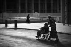 CARTHAGINIAN COUPLE (N A Y E E M) Tags: couple pilgrims tunisian cathaginian afternoon wheelchair street madinah ksa saudiarabia