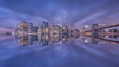 Manhattan Reflection (Raúl Podadera Sanz) Tags: newyork manhattan refection sea water brooklyn bridge clouds longexposure building