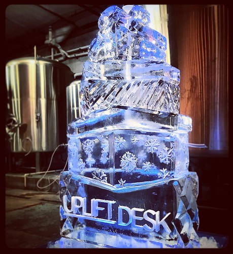 This stack of ice presents will be providing the gift of cold drinks for the @upliftdesk #holiday #party @4thtap tonight. Shoutout to @griffonramsey on a job well done! #fullspectrumice #thinkoutsidetheblocks #brrriliant - Full Spectrum Ice Sculpture
