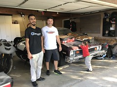 This Nova was our son's first car 28 yrs ago ( Anthony white tee-shirt ) sold it to our grandson ( Bobby black tee-shirt ) great-grandson ( Nicholas ) red shirt scribbled his name on the hood and tells us it's his car . (Bob the Real Deal) Tags: 1973chevynova 1973nova cool car firstcar nicholas anthony bobby