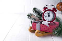 New Year's clock. (lyule4ik) Tags: box gift time clock alarm background christmas decoration holiday midnight new red winter year celebration copy eve greeting pine retro snow tree vintage wood wooden xmas ribbon old branch design happy merry night cone present santa shiny white copyspace decorative fir nature space card concept countdown event expectation frost gold