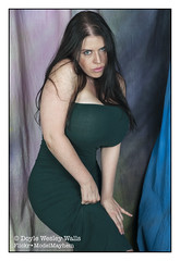 Aviva, Portrait in Her Tight Green Dress (Doyle Wesley Walls) Tags: ar 0177 woman girl female sexy beautiful curvy bigbreasts curvaceous chest breasts hips photo photograph portrait avivarosen doylewesleywalls body figure