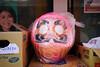 Daruma in plastic (Eric Flexyourhead) Tags: kamata 蒲田 otaku 大田区 tokyo 東京 japan 日本 city urban detail fragment buddhist buddhism daruma 達磨 pink sonyalphaa7 zeisssonnartfe35mmf28za zeiss 35mmf28