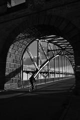 contrasts with cyclist (liebeslakritze) Tags: contrasts steel stones bridge cyclist blackwhite bw schwarzweis sw brücke kontaste stein stahl monochrome