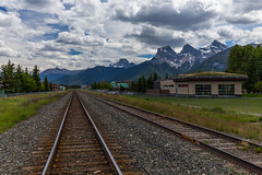 Canadian Pacific Railway Line Crossing Town of Canmore (tvrdypavel) Tags: alberta aspen autumn banff bowvalley canada canadian canadianpacific canmore chinook color cprail distant fallcolors foothills landscape line mountain nationalpark natural nature outdoor panorama panoramic perspective rail railline railroad railroadcrossing railroadtracks railway rockies rockymountains symmetrical symmetry threesisters train trainline transport transportation western ca