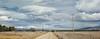 Mental Notes of a Big-sky Country (Peter Kurdulija) Tags: geo:lat=4502893440 geo:lon=17000515800 geotagged newzealand nzl otago wedderburn new zealand maniototo plain hill winter travel snow sky white cloud paddock nature gravel dirt road rural wide countryside panorama kurdulija