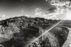 Avoncliff Aqueduct (Evoljo) Tags: avoncliff wiltshire sunlight sun rays bridge avoncliffaqueduct sky trees blackwhite nikon d500 fisheye