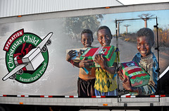 Happy Smiles (Poocher7) Tags: people portrait children africanchildren occshoeboxes shoeboxes operationchristmaschild occ smaritanspurse transporttruck 18wheeler trailer phot boys smiles happy joy love sharing givng nonprofitorganization internationalrelief warehouse guelph ontario canada distributioncentre