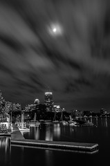 On a windy night (Rabican7) Tags: boston massachusetts skyline river night monochrome blackandwhite landscape urban lights longexposure pier calmness windy cloudy clouds nikon city bw