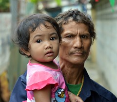 a stern look (the foreign photographer - ฝรั่งถ่) Tags: man stern look baby khlong bang bua portraits bangkhen bangkok thailand nikon
