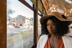Riding Through the Garden District (sullivan1985) Tags: woman portrait wife marie neworlenas nola frenchquarter stcharles trolley streetcar norta lady younglady hat curls necklace heart bokeh window