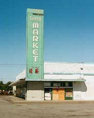 Super Market (Travis Estell) Tags: 35mmfilm california californiaonfilm canonae1 kodakportra400 portra400 sanjose sanjoseonfilm santaclaracounty thedarkroom thedarkroomlab abandoned film supermarket unitedstates us