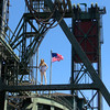 Agoraphobia or Acrophobia (swong95765) Tags: woman blonde female high bridge structure balanced fearless flag