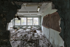 Hole in the wall classroom (Dennis van Dijk) Tags: forgotten abandoned derelict decay precious beauty lost found rust dust chernobyl pripyat exclusion zone explosion nuclear disaster blast cccl ussr soviet town village broken urban exploration strange eerie red hospital school piano music gym olympics olympic games sport game night clash children camp summer retreat