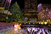 Christmas at Rockefeller Center in New York City (` Toshio ') Tags: toshio nyc newyorkcity manhattan newyork rockefellercenter christmastree christmas iceskating rink people city america tree fujixt2 xt2 skating lights flag statue skyscraper