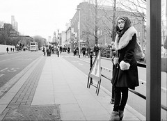 expecting snow (streetstory) Tags: manchester england 2017 bw streetphotography hijab glasses girlatbusstop oxfordroad universitybuildings candid wintercoat