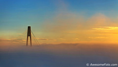 Foggy morning glow (james c. (vancouver bc)) Tags: sunlight river winter travel blue yellow orange sunrise canada waterfront morning skytrain bridge beauty scene dramatic newwestminster vancouver urban fraserriver britishcolumbia glow silhouette cloud dusk twilight sky panorama panoramic view landscape wideangle riverbank surrey fog mist cable tower foggy misty