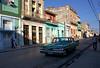 much admired car (againandagain251) Tags: cienfuegos cuba classiccar streetlife colourfulbuildings greencar pavement sidewalk