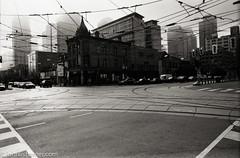 Intersection (johnlishamer.com) Tags: 2017 35mm canada ilforddelta100 lakeontario lishamer nikonf3 ontario slr toronto city film johnlishamercom roadtrip urban vacation