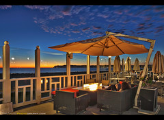 Enjoying a relaxing sunset at the Hotel del Coronado (Sam Antonio Photography) Tags: hoteldelcoronado sandiego sunset bar coronado people hotel california architecture vacation outdoor southern structure accommodations building balcony table luxury historical glamour tourism victorian samantoniophotography fire pit relaxing leisure evening