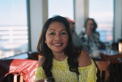 Leah enjoying a late lunch (poavsek) Tags: coast california film kodak medalist portra 160 cruz santa wharf restaurant seafood