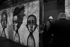 Two States (Arindam's Photography) Tags: arindam arindamghosh canon canont2i candid street chicago illinois us usa 550d t2i tamron tamron1750mmf28 tamron1750 blackandwhite black white people perspective frame graphiti wicker wickerpark explore