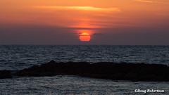 Paphos Sunset (DougRobertson) Tags: paphos cyprus seaside sea sunset sunshine water rocks waves holiday louisledrabeachhotel clouds orange
