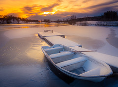 The Frozen Boat (andreassofus) Tags: winter snow boat jetty ice lake frozenlake sunset evening december sky clouds color colorful nature landscape outdoor cold white beautiful sweden värmland töcksfors water reflections