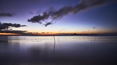 Sunset over small island (Yuta Uch) Tags: sunset sunrise sunshine exposure longexposure slow shutter clouds cloudscape sea ocean seashore seascape