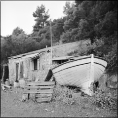 Old fisherman's home (BG Sixtyniner) Tags: hellas ellada greece island euboea agkali agiaanna fisherman boat house ruin abandoned old neglected rocky home drydock film analog square 6x6 120 roll mediumformat bw blackandwhite ilford panfplus 50asa homedev paterson standev standdevelope rodinal 1100 carlzeiss planar f28 80mm hasselblad 500cm canoscan 9000f vuescan
