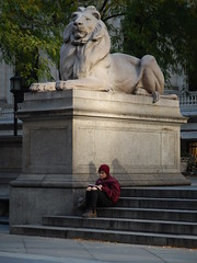 Patience and lady (C_Oliver) Tags: patienceandfortitude stone lion statue plinth usa america newyork manhattan 5thavenue 41ststreet patience fortitude sculpture steps lady woman cap marble