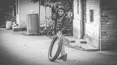 Untitled (#Weybridge Photographer) Tags: canon slr dslr eos 5d mk ii nepal kathmandu asia mkii boy child tyre tire play playing monochrome