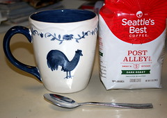 Coffee. (dccradio) Tags: lumberton nc northcarolina robesoncounty indoors inside arbicacoffee seattlesbest coffee darkroast spoon coffeecup mug chicken hen rooster blue white drink counter morning goodmorning kitchen kitchencounter nikon d40 dslr