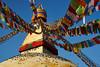 Pigeons taking sun on the Buddhist stupa of Boudhanath, Kathmandu, Nepal (Alex_Saurel) Tags: asia culture stupa architecture tradition photoreport bluesky stûpa बौद्धनाथ yeux cielbeu prayerflags kathmandu asian tibetanflags day reportage byarungkhashor drapeauàprière travel 35mmprint mandala bouddhisme nepal religion photospecs jarungkhashor eyes boudhanath bodnath sanctuairebouddhiste imagetype khāsacaitya asie photojournalism katmandou bouddhanath buddhistsanctuary khāsti scans stockcategories eyesofboudhanath buddhism time photoreportage thegreatstupa buddhiststupa sony50mmf14sal50f14