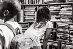 browsing at the book market (Gerard Koopen) Tags: nederland netherlands denhaag thehague bookmarket browsing books candid straat street straatfotografie streetphotography nikon d810 blackandwhiteonly blackandwhite people woman girl 2017 gerardkoopen