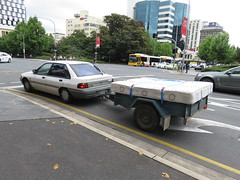 Ford Laser sedan towing trailer with mattress (RS 1990) Tags: adelaide southaustralia friday 1st december 2017 ford laser sedan trailer mattress grenfellst