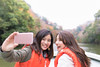 Happy sisters taking selfie picture on tour boat (Apricot Cafe) Tags: img72371 asia asianandindianethnicities healthylifestyle japan japaneseethnicity tamronsp35mmf18divcusdmodelf012 autumn autumnleafcolor backlit bridge candid carefree casualclothing charming cheerful chibaprefecture colorimage copyspace enjoyment forest happiness lake leisureactivity lifejacket lifestyles mountain onlyjapanese outdoors people photographing photography realpeople relaxation selfie sister smartphone smiling sunlight sustainablelifestyle threequarterlength togetherness toothysmile tourboat tourism tourist traveldestinations twopeople waistup weekendactivities women youngadult