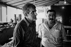At the border of Iran and Iraq, in a bar that is not even a bar, just a little place to drink a tea, I met this two guys (rvjak) Tags: iran iraq irak middleeast moyenorient hommes men black white noir blanc bw d750 nikon travel voyage