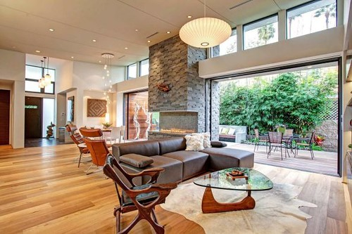 outdoor-living-room-with-fireplace-white-tile-floor-rattan-varnish-chair-white-floor-fireplace-brown-wood-varnished-table-brown-varnished-wooden-table--593x395