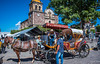 2017 - Mexico - Tequila - Tourist Conveyance (Ted's photos - For Me & You) Tags: 2017 cropped mexico nikon nikond750 nikonfx tedmcgrath tedsphotos tedsphotosmexico tequila vignetting canopy tequilajalisco tequilapuebomágico tequilatour santiagodetequila magictownsofmexico pueblomágico pueblosmagicos jalisco horse streetscene street people peopleandpaths shadow shadows wheels carriage paseoencalandria church churchdome clock clockface denim denimjeans hat bluesky blue