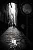 Florence noir (damar47) Tags: pentax k30 blackwhite monochrome monochromatic blackandwhite dark shadows streetphotography streetview street pentaxart italy italia florence firenze vicolo puddle old city