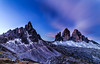Face Off: Monte Paterno Vs. Tre Cime (One_Penny) Tags: dolomiten italy dolomites hiking landscape mountains nature photography canon6d 14mm wideangle montepaterno trecime trecimedilavaredo faceoff mountain snow longexposure sky blue clouds peaks summit ndfilter longshutterspeed dreizinnen paternkofel