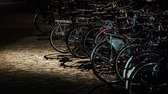Spotlight on bicycles (PhredKH) Tags: amsterdam canon canoneos canonphotography fredkh photosbyphredkh phredkh travelphotography afterdark nightphotography nightscene netherlands bicycles canoneos7dmarkii ef70200mmf28lisiiusm bike wheel spotlight