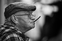 Chewing ..... something or other (Frank Fullard) Tags: frankfullard fullard candid street portrait mystery chewing cap plaid castlebar mayo irish ireland lol fun bokeh diy diychewinggum gum