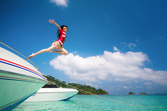 Asian lady jump and fly to sky between travel the Thailand sea (I love landscape) Tags: beach jumping woman jump person summer happy joy young sea female girl fun lady vacation outdoor travel holiday white water blue ocean people sky nature boat kood kam mak pattaya phuket phi samui thai asia asian lifestyle freedom fly tropical sand dream free women sunny waves play relax resort krabi island koh